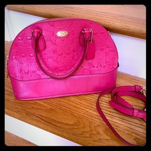 Coach purse hot pink, lotsa life left in this girl